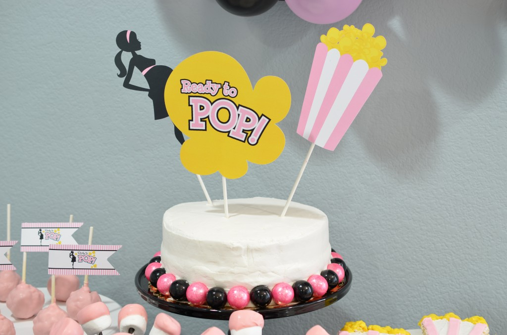 Ready To Pop Baby Shower Pink white cake with gumballs
